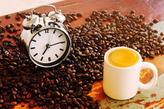 Coffee beans and cup of coffee and alarm clock Stock Photography