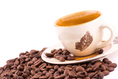 Coffee beans and cup of coffee background Stock Photos