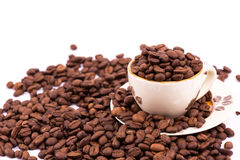 Coffee beans and cup of coffee background Royalty Free Stock Photo