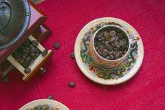 Coffee beans in a cup with a pattern stock photos