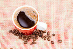 Coffee beans and cup with coffee Stock Photo