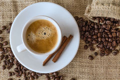 Coffee beans, a cup of coffee, cinnamon Royalty Free Stock Photo