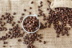 Coffee beans, a cup of coffee, cinnamon Stock Photos
