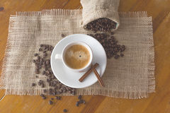 Coffee beans, a cup of coffee, cinnamon Royalty Free Stock Images