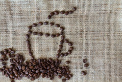 Coffee beans, a cup of coffee, cinnamon Stock Photography