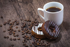 Coffee beans with cup of coffee and donuts Stock Photo