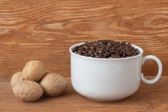 Coffee beans in a cup royalty free stock photo