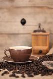 Coffee beans, a cup and a coffee grinder Royalty Free Stock Image