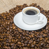 Coffee beans and cup of coffee. Selective focus Royalty Free Stock Photo