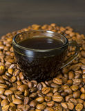 Coffee Beans, Cup on Dark Background Stock Photo