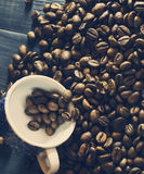 Coffee beans with a cup Stock Photography