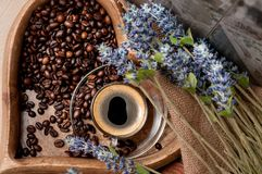 Coffee beans and a cup of espresso Stock Images