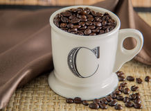 Coffee beans in a cup. Fresh coffee beans inside a coffee mug Royalty Free Stock Images
