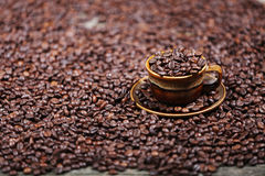 Coffee beans in a cup. A cup full of coffee beans Stock Photo