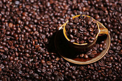 Coffee beans in a cup. A cup full of coffee beans Stock Photos