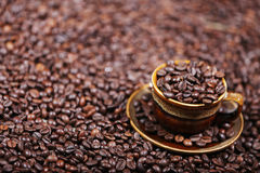 Coffee beans in a cup. A cup full of coffee beans Royalty Free Stock Photo
