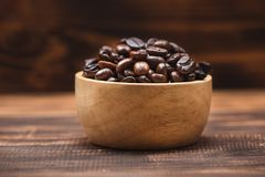 Coffee beans. Coffee cup full of coffee beans. Coffee beans. Coffee cup full of coffee beansn Stock Photos