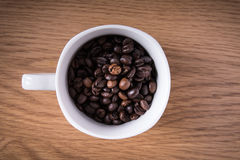 Coffee beans and cup full of coffee. Coffee beans and cup full of coffee Stock Image