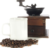 Coffee beans, cup and grinder on white Royalty Free Stock Image