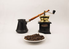 Coffee beans in the Cup with a grinder on white background Stock Images