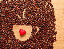 Coffee beans cup and heart Royalty Free Stock Photo