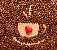 Coffee beans cup and heart Royalty Free Stock Photography