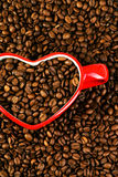 Coffee beans with cup Stock Photos
