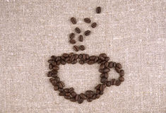 Coffee beans cup. Cup of coffee linen background Royalty Free Stock Images
