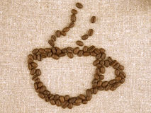 Coffee beans cup. Cup of coffee linen background Stock Photos