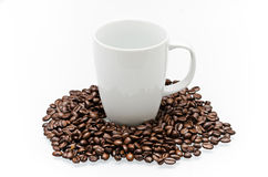 Coffee beans and cup Stock Image