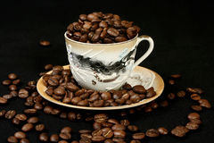 Coffee beans in a cup of oriental style Royalty Free Stock Images