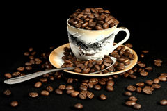 Coffee beans in a cup of oriental style Stock Photos