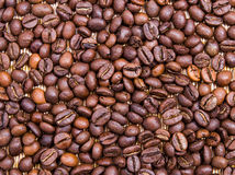 Coffee Beans. Cup of coffee and coffee beans on a placemat in front of the window Stock Photos