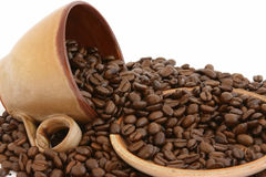 Coffee beans with cup and plate Stock Photos