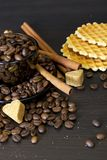 Coffee beans, cup, Pots, cinnamon on dark Royalty Free Stock Photography