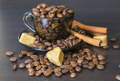 Coffee Beans, Cup, Pots, Cinnamon on Dark Stock Photo