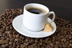 Coffee beans, cup, Pots, cinnamon on dark Royalty Free Stock Photos