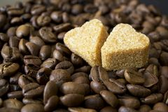 Coffee beans, cup, Pots, cinnamon on dark Royalty Free Stock Photo