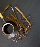Coffee beans, cup, Pots, cinnamon on dark Stock Image