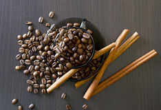 Coffee beans, cup, Pots, cinnamon on dark Royalty Free Stock Photos