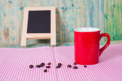 Coffee beans with  cup Royalty Free Stock Photos