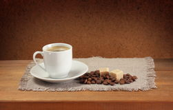Coffee beans, cup, saucer, sugar, napkin Stock Photo