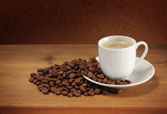 Coffee beans, cup and saucer Stock Photos