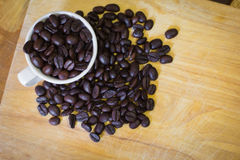 Coffee beans and Cup. Some coffee beans in the kitchen interior Royalty Free Stock Image