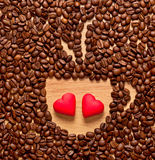 Coffee beans cup and two heart Royalty Free Stock Photo