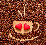 Coffee beans cup and two heart Royalty Free Stock Photography