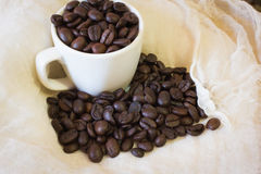 Coffee beans and Cup. Coffee beans on a vintage canvas Stock Photo