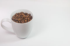 Coffee beans in a cup. On white background stock photo