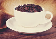 Coffee Beans. In  a cup on wood Royalty Free Stock Photo