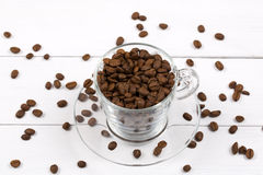 Coffee beans in the cup Royalty Free Stock Images